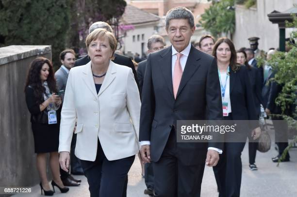 German Chancellor Angela Merkel and her husband Joachim Sauer arrive for a concert of La Scala Philharmonic Orchestra at the ancient Greek Theatre of...
