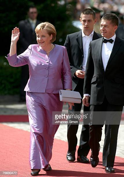 German Chancellor Angela Merkel and her husband Joachim Sauer arrive for the premiere of the Richard Wagner festival on July 25 2007 in Bayreuth...