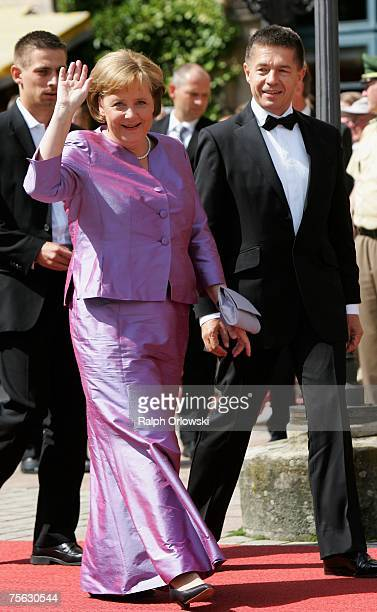 German Chancellor Angela Merkel and her husband Joachim Sauer arrive for the premier of the Richard Wagner festival July 25 2007 in Bayreuth Germany