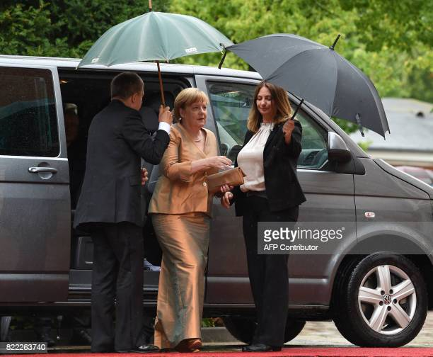 German chancellor Angela Merkel and her husband Joachim Sauer arrive at the Festival Theatre on July 25 in Bayreuth southern Germany ahead of the...