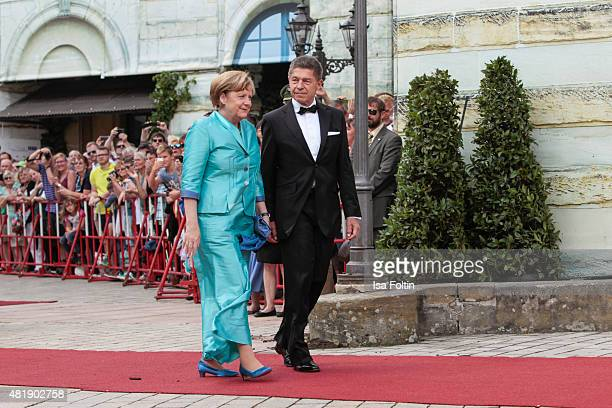 German Chancellor Angela Merkel and her husband Joachim Sauer attend the Bayreuth Festival 2015 Opening on July 25 2015 in Bayreuth Germany