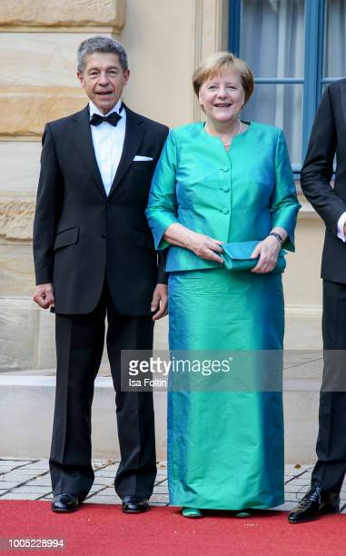German Chancellor Angela Merkel and her husband Joachim Sauer during the opening ceremony of the Bayreuth Festival at Bayreuth Festspielhaus on July...