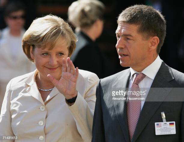 German Chancellor Angela Merkel and her husband Joachim Sauer wait for the arrival of US President George W Bush on July 13 2006 in Stralsund Germany...