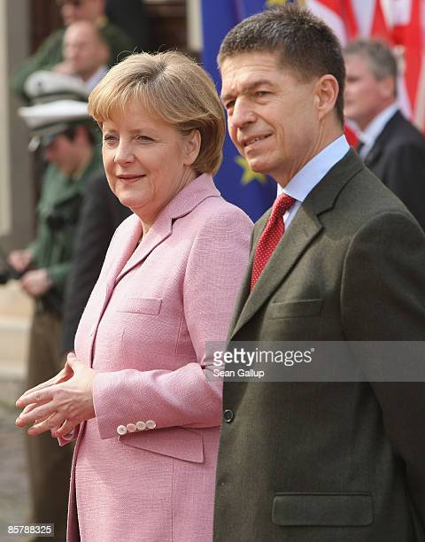 German Chancellor Angela Merkel and her husband Joachim Sauer wait for the arrival of US President Barack Obama and his wife Michelle before...
