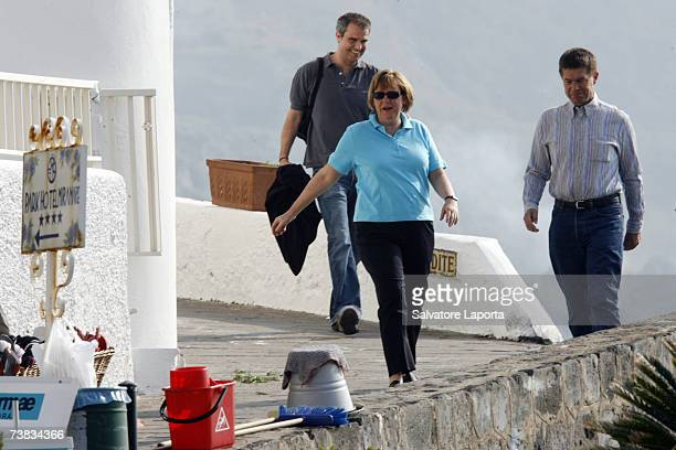 German Chancellor Angela Merkel and her husband Joachim Sauer walk in the coastal town of Sant'Angelo d'Ischia on the Island of Ischia during their...