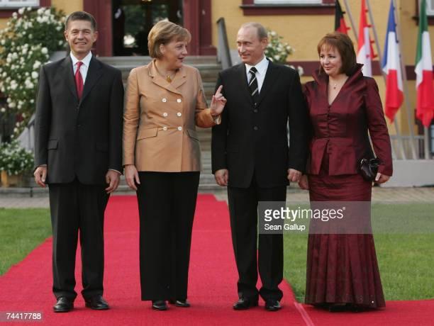 German Chancellor Angela Merkel and her husband Joachim Sauer welcome Russian President Vladimir Putin and his wife Lyudmila Putina at the opening...