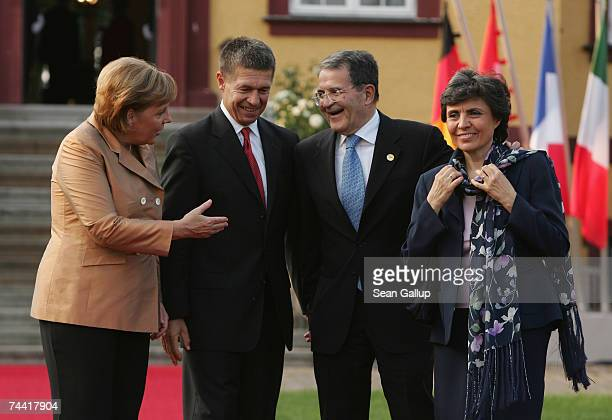 German Chancellor Angela Merkel and her husband Joachim Sauer welcome Italian Prime Minister Romano Prodi and his wife Flavia Franzoni Prodi at the...