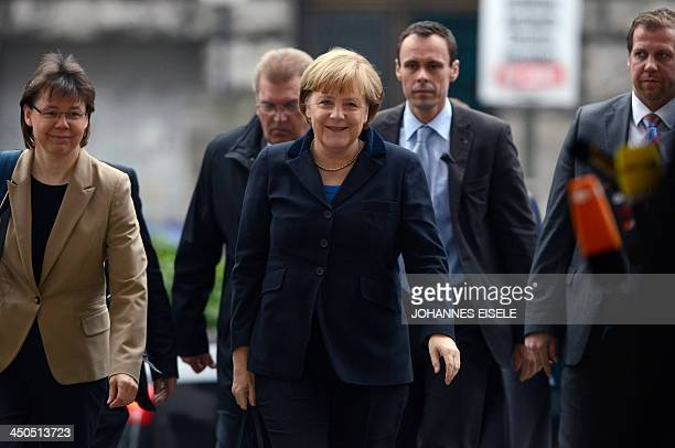 German Chancellor Angela Merkel and her office manager Beate Baumann arrive for coalition talks of members of the conservative CDU/CSU union and the...
