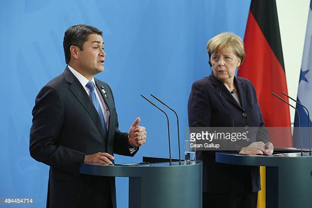 German Chancellor Angela Merkel and Honduran President Juan Orlando Hernandez speak to the media following talks at the Chancellery on October 27,...