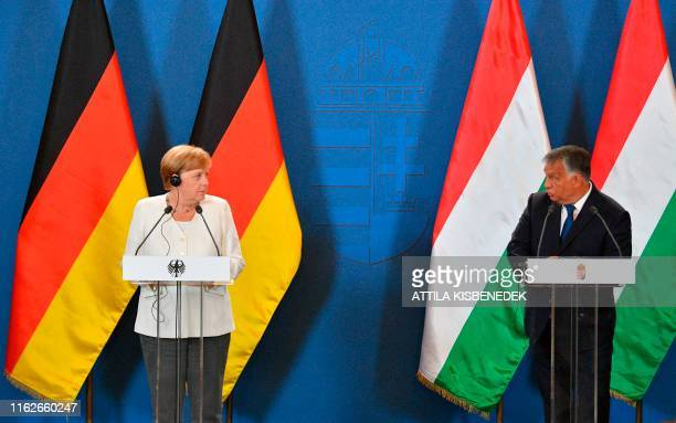 German Chancellor Angela Merkel and Hungarian Prime Minister Viktor Orban give a press conference during their meeting in the HungarianAustrian...