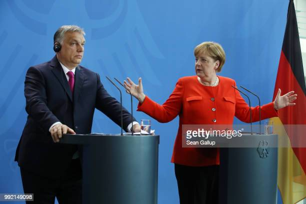 German Chancellor Angela Merkel and Hungarian Prime Minister Viktor Orban speak to the media following talks at the Chancellery on July 5 2018 in...