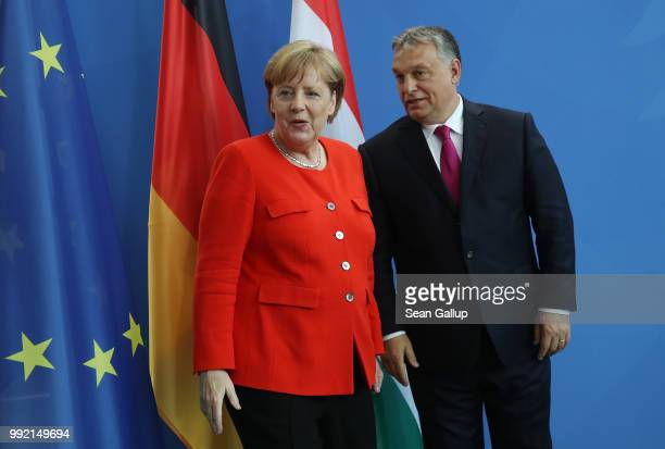 German Chancellor Angela Merkel and Hungarian Prime Minister Viktor Orban depart after speaking to the media following talks at the Chancellery on...