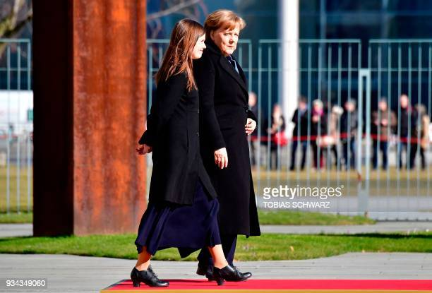 German Chancellor Angela Merkel and Iceland's Prime Minister Katrin Jakobsdottir are pictured during a welcoming ceremony ahead of talks at the...