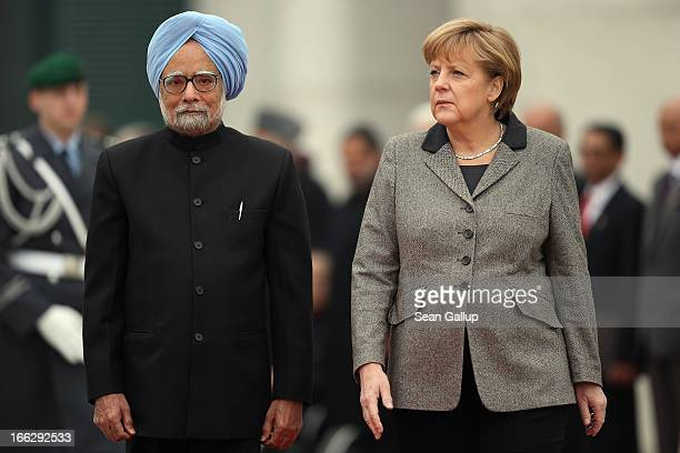 German Chancellor Angela Merkel and Indian Prime Minister Manmohan Singh prepare to review a guard of honour upon Singh's arrival at the Chancellery...