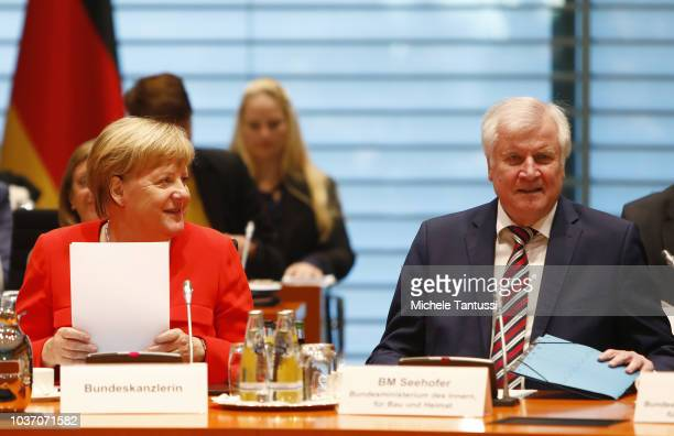 German Chancellor Angela Merkel arrives for a press conference after the government summit on housing policy on September 21 2018 in Berlin Germany...