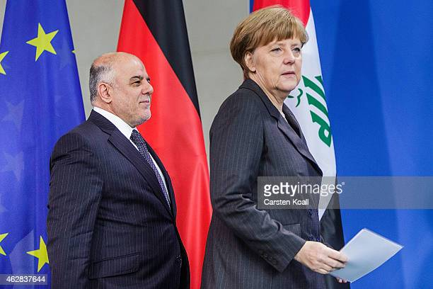 German Chancellor Angela Merkel and Iraqi Prime Minister Haider AlAbadi arrive for a press conference at the Chancellery following talks on February...