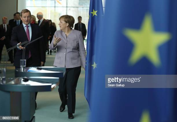 German Chancellor Angela Merkel and Irish Prime Minister Enda Kenny arrive to speak to the media at the Chancellery on April 6 2017 in Berlin Germany...