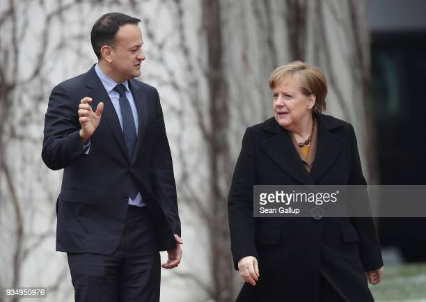 German Chancellor Angela Merkel and Irish Prime Minister Leo Varadkar prepare to review a guard of honor upon Vardkar's arrival at the Chancellery on...
