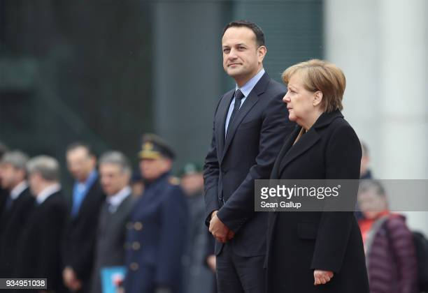 German Chancellor Angela Merkel and Irish Prime Minister Leo Varadkar review a guard of honor upon Vardkar's arrival at the Chancellery on March 20...
