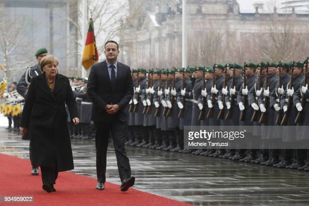 German Chancellor Angela Merkel and Irish Prime Minister Leo Varadkar review a guard of honour at the courtyard of the German Chancellory on March 20...