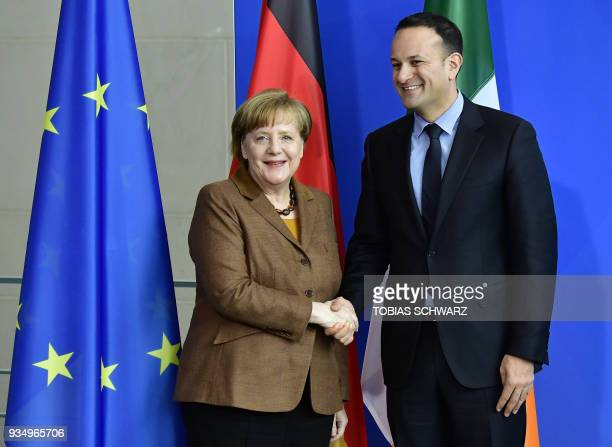 German Chancellor Angela Merkel and Irish Prime Minister Leo Varadkar shake hands after a news conference on their talks in Berlin on March 20 2018 /...