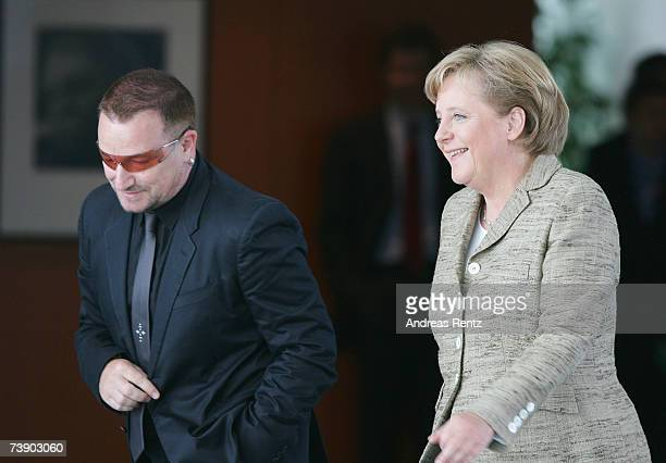 German Chancellor Angela Merkel and Irish rock singer Bono arrive at the chancellor's office, on April 17, 2007 in Berlin, Germany. Merkel is to...