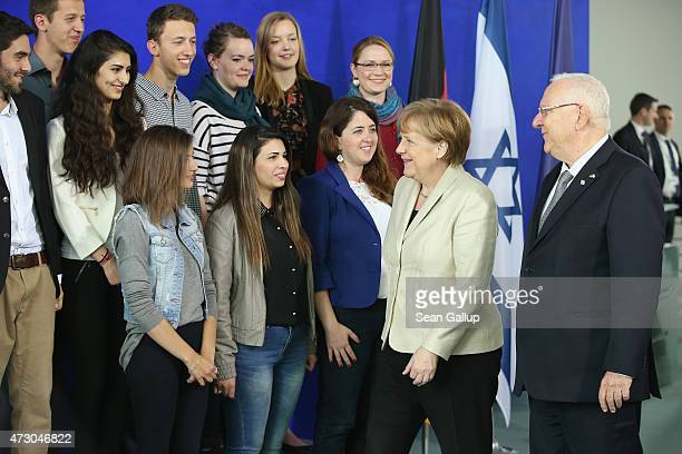 German Chancellor Angela Merkel and Israeli President Reuven Rivlin arrive for a group photo with members of a German-Israeli youth congress at the...