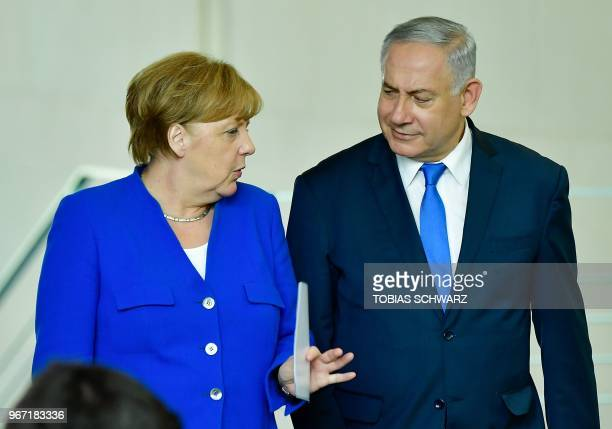 German Chancellor Angela Merkel and Israeli Prime Minister Benjamin Netanyahu arrive to address a press conference after a meeting at the Chancellery...