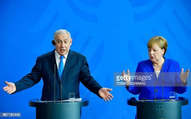 German Chancellor Angela Merkel and Israeli Prime Minister Benjamin Netanyahu address a press conference after a meeting at the Chancellery in Berlin...