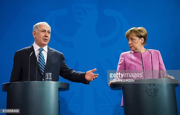 German Chancellor Angela Merkel and Israel's prime minister Benjamin Netanyahu speaks at a press conference at the Chancellery in Berlin on February...