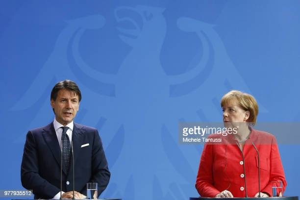 German Chancellor Angela Merkel and Italian Prime Minister Giuseppe Conte address the media upon's Conte's arrival at the Chancellery on June 18 2018...