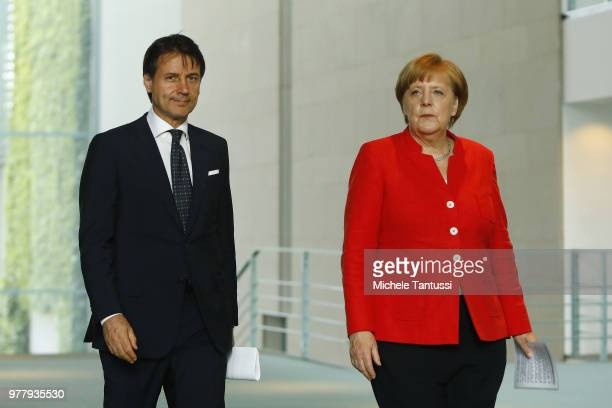 German Chancellor Angela Merkel and Italian Prime Minister Giuseppe Conte arrive to address the media upon's Conte's arrival at the Chancellery on...