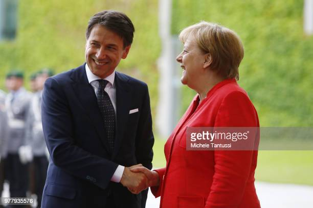 German Chancellor Angela Merkel and Italian Prime Minister Giuseppe Conte chat upon Conte's arrival at the Chancellery on June 18, 2018 in Berlin,...