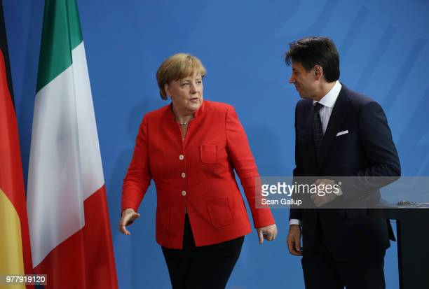 German Chancellor Angela Merkel and Italian Prime Minister Guiseppe Conte depart for bilateral talks after giving statements to the media at the...