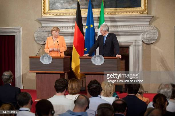 German chancellor Angela Merkel and Italian Prime Minister Mario Monti attend a press conference at the end of a bilateral meeting at Villa Madama on...