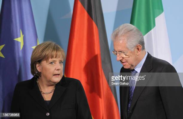 German Chancellor Angela Merkel and Italian Prime Minister Mario Monti depart after speaking to the media following talks at the Chancellery on...
