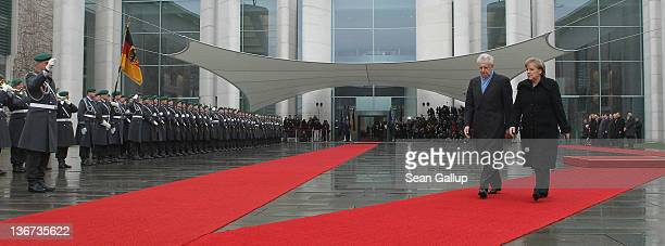 German Chancellor Angela Merkel and Italian Prime Minister Mario Monti prepare to review a guard of honour upon Monti's arrival at the Chancellery on...