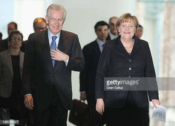 German Chancellor Angela Merkel and Italian Prime Minister Mario Monti arrive to speak to the media after talks at the Chancellery on January 11,...