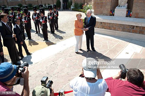 German chancellor Angela Merkel and Italian Prime Minister Mario Monti, arrive to attend a bilateral meeting at Villa Madama on July 4, 2012 in Rome,...