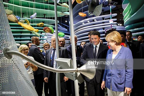 German Chancellor Angela Merkel and Italian Prime Minister Matteo Renzi take a tour of the German Pavilion at the Expo 2015 on August 17 2015 in...