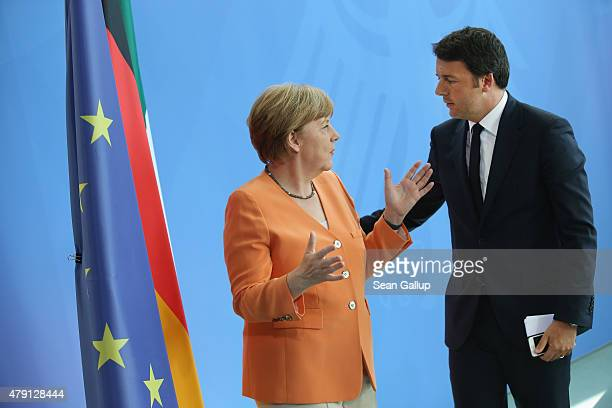 German Chancellor Angela Merkel and Italian Prime Minister Matteo Renzi depart after speaking to the media following talks at the Chancellery on July...