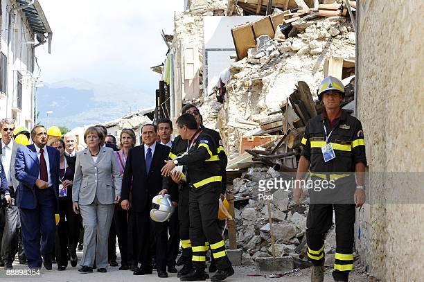 German Chancellor Angela Merkel and Italian Prime Minister Silvio Berlusconi visit quake-ravaged hamlet Onna on July 08, 2009 in Onna, Italy. The...