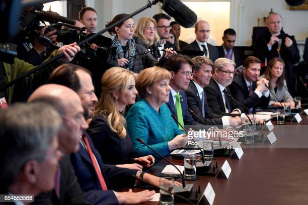 German Chancellor Angela Merkel and Ivanka Trump particapate in a roundtable discussion on vocational training with United States and German business...