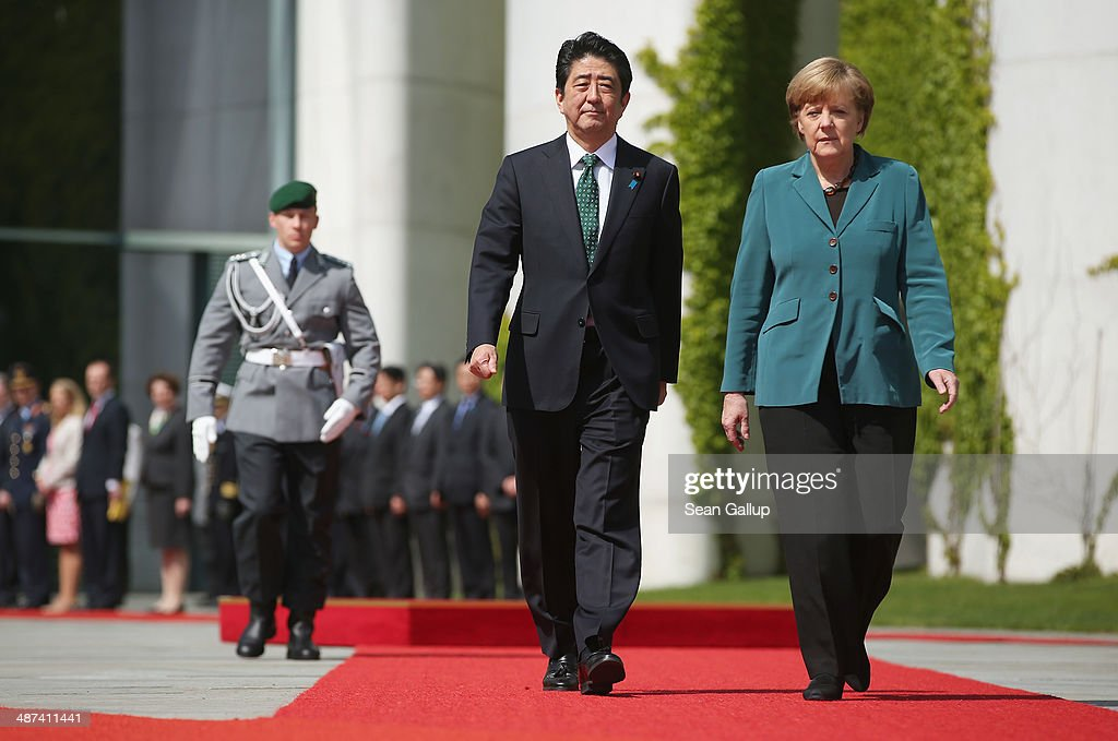 German Chancellor Angela Merkel and Japanese Prime Minister Shinzo Abe prepare to review a guard of honour upon Abe's arrival at the Chancellery on April 30, 2014 in Berlin, Germany. The two leaders are meeting on a variety of issues, including the current crisis in eastern Ukraine.