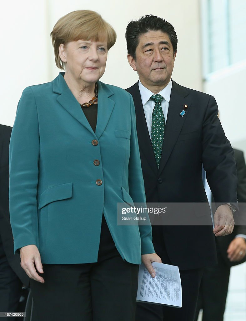 German Chancellor Angela Merkel and Japanese Prime Minister Shinzo Abe arrive to speak to the media following talks at the Chancellery on April 30, 2014 in Berlin, Germany. The two leaders are meeting on a variety of issues, including the current crisis in eastern Ukraine.