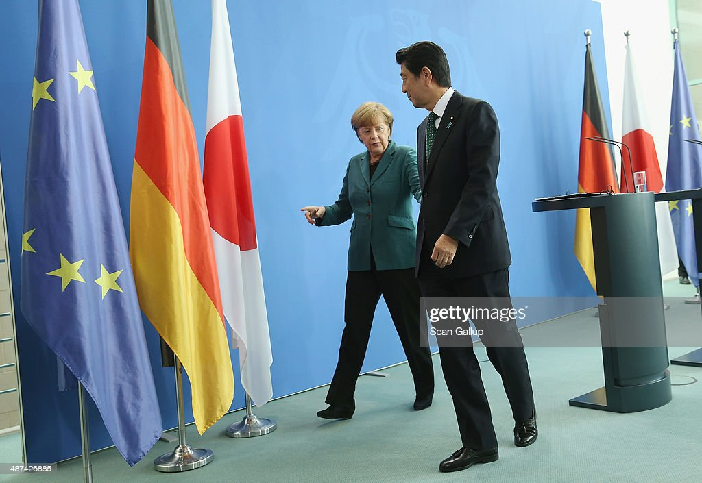 German Chancellor Angela Merkel and Japanese Prime Minister Shinzo Abe depart after speaking to the media following talks at the Chancellery on April 30, 2014 in Berlin, Germany. The two leaders are meeting on a variety of issues, including the current crisis in eastern Ukraine.