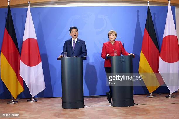German Chancellor Angela Merkel and Japanese Prime Minister Shinzo Abe speak to the media during a joint press conference following talks at Schloss...