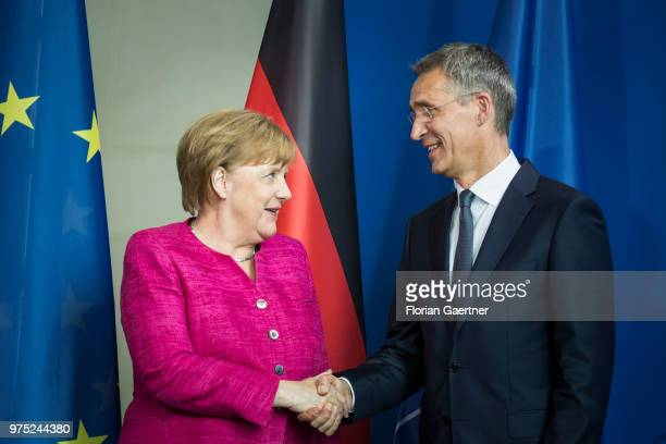 German Chancellor Angela Merkel and Jens Stoltenberg Secretary General of the NATO shake hands after a press conference on June 15 2018 in Berlin...