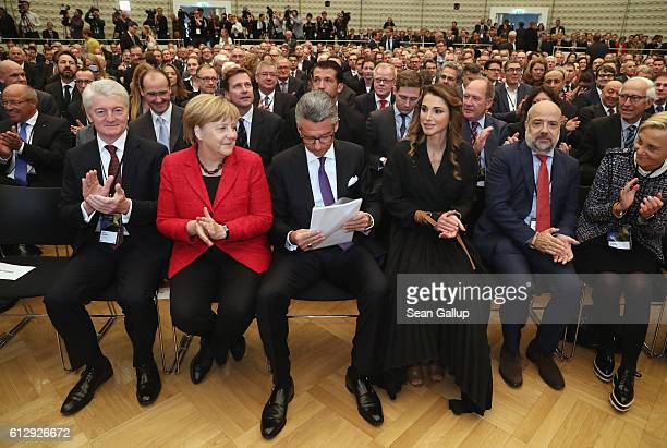 German Chancellor Angela Merkel and Jordanian Queen Rania of Jordan sit next to Ulrich Grillo President of the Federation of German Industry at the...