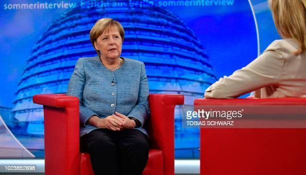 German Chancellor Angela Merkel and journalist Tina Hassel have taken seat at a tv studio of German public broadcaster ARD for Merkel's traditional...